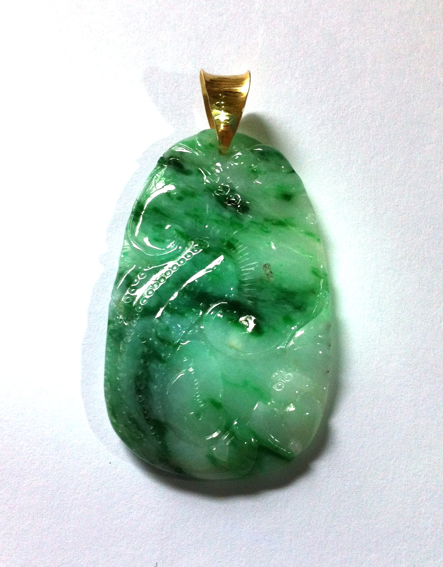 Jade pendant with gold bail